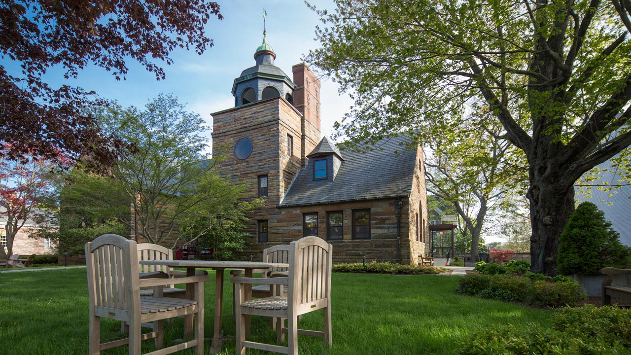 Lawn furniture outside architecturally interesting stone library